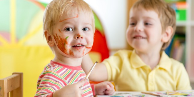smiling kids boys paint at home or playschool